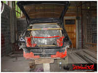 The first thing to do was to install the C-pillar part of the roll cage, to keep the rear end from deforming.