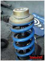 The shocks use their own special top mount bearings, which were in good condition.