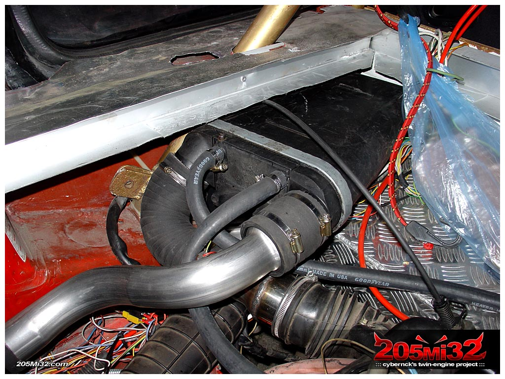 ...and another custom enlargening pipe to join up the chargecooler to the inlet manifold. Also, we connected water hoses at this stage.