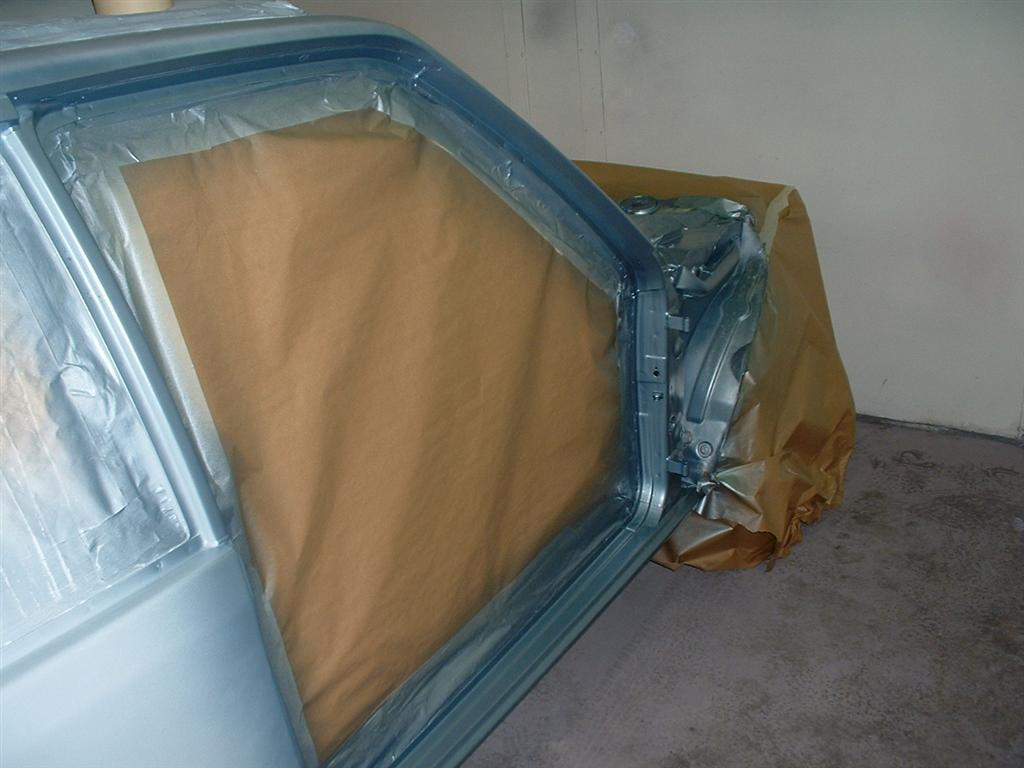 Basecoat being applied to the door appertures