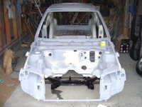 Put the freshly black painted subframe onto the shell